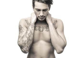 Beautiful naked man with tattos