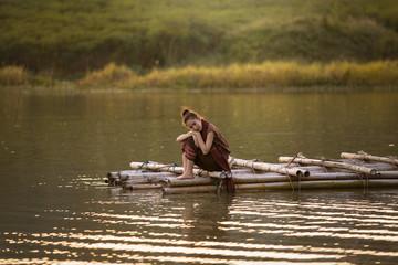 Alone woman on bamboo raft