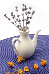 Small porcelain jug with dry lavender flowers
