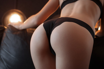 Beautiful ass of a young girl in black underwear