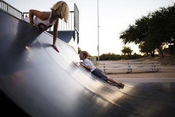Two children playing on slide