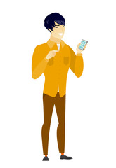 Asian business man holding a mobile phone.