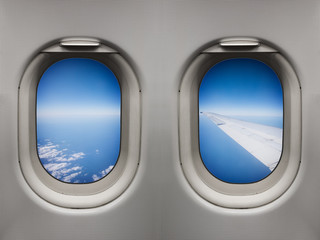 Wing view over the sea inflight from inside an airplane windows