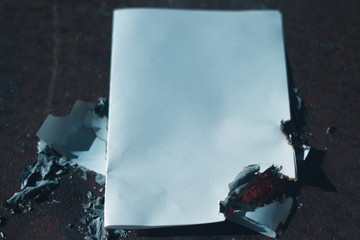 Charred the paper sheet on dark