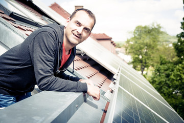 Home Owner Is Happy With Solar Panels On His Roof