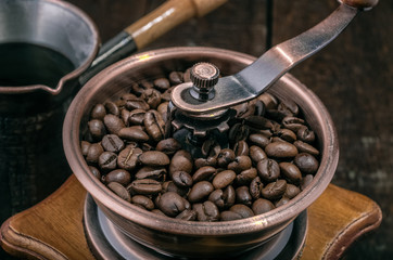 Close up  coffee grinder with beans