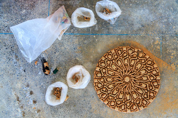Making of Moroccan mosaic in a factory placing the tiles upside