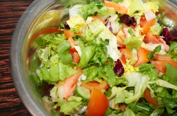 Fresh salad with tomatoes and cucumbers. green
