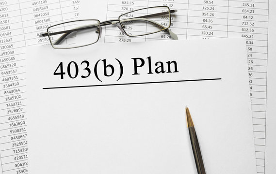 Paper with 403 b plan on a table