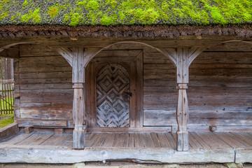 Door and doorstep of wooden rural storehouse, Nothern Europe.