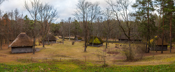 Panoramic view of the rustic farm houses, peasant household. Wooden architecture of North and Baltics