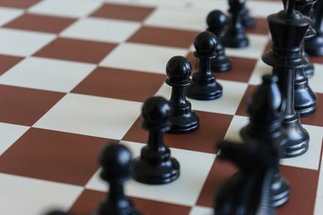White chess pieces on the starting position.