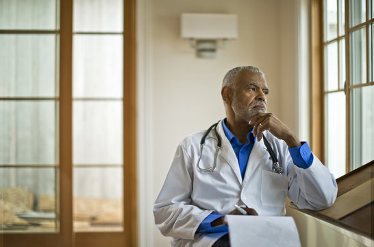 Doctor sitting and looking out through the window