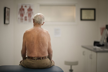 Senior man sitting in a doctor's office.