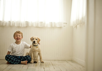 Portrait of young boy with his dog.