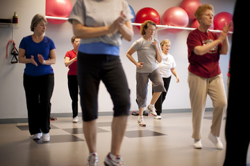 Elderly women doing an exercise class.