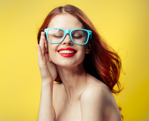 woman in glasses on a yellow background, a woman with glasses, woman