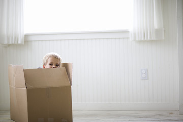 Portrait of a young boy in a box.
