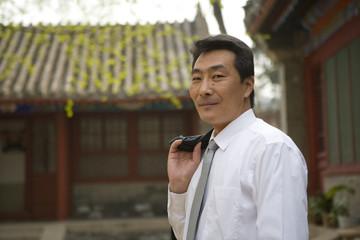 Portrait of a mid-adult businessman outside a building.