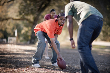 People playing American Football in park