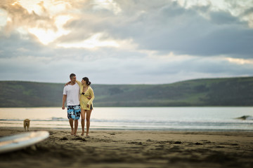 Middle aged couple walking together on the beach.