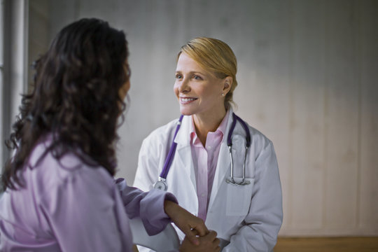 Female doctor talking with patient in clinic
