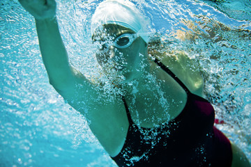 Female swimmer swimming the front crawl.