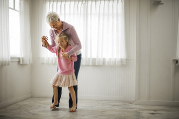 Happy little girl has fun with her smiling grandmother.