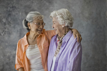 Portrait of two smiling senior woman.