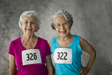 Portrait of two smiling senior women.