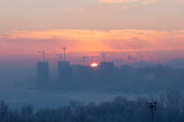 The sunrise in the city during winter / north of Russia