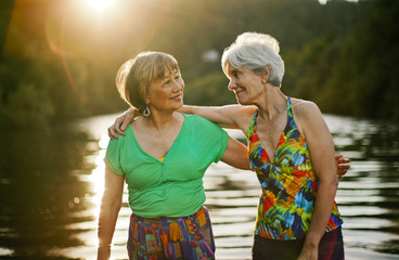 Two smiling senior women having fun while on summer holiday together.