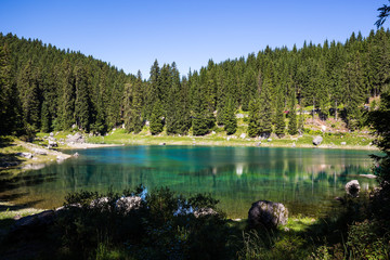 Wall Mural - View of Karersee (Lago di Carezza), one of the most beautiful alpine lakes in the Italian Dolomites.
