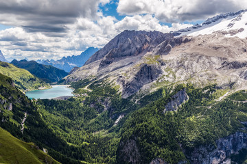 Wall Mural - View of the Marmolada, also known as the Queen of the Dolomites and the Fedaia Lake. Marmolada is the highest mountain of the Dolomites, situated in northeast of Italy.