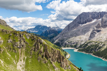 Fototapete - View of the Marmolada, also known as the Queen of the Dolomites and the Fedaia Lake. Marmolada is the highest mountain of the Dolomites, situated in northeast of Italy.