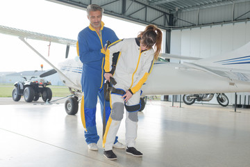 preparation of parachutes for sky divers in hangar