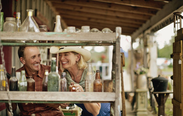 Smiling mature couple have fun shopping at the antique store together.