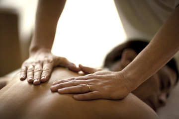 Middle-aged woman receiving a pampering and relaxing massage at a health spa.
