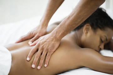Mid-adult woman getting a massage.