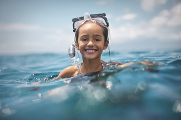 Girl snorkeling in sea