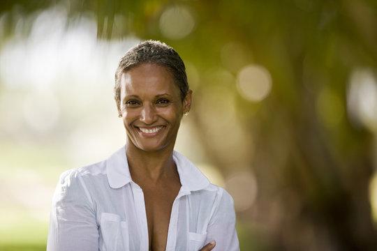 Portrait of a woman smiling wearing a white shirt.