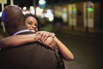 Couple embracing on street