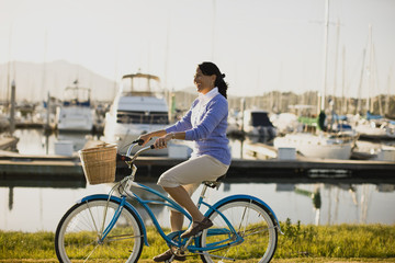 Mature woman riding her bike at the waterfront