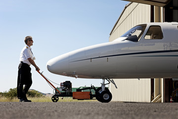 Pilot preparing a plane for take off