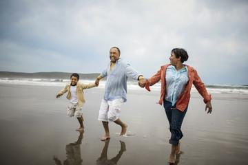 Family enjoying day at beach.