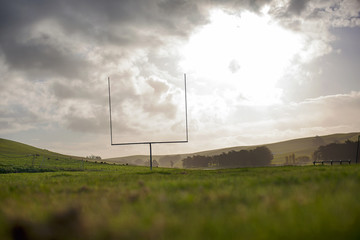 American football goal post in a field.