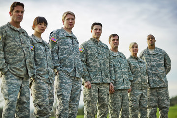 Portrait of a group of US Army soldiers standing in a line.