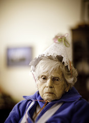 Senior woman wearing party hat