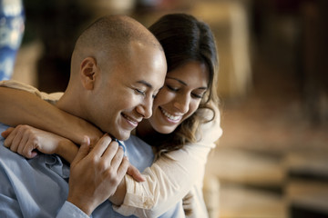Smiling mid adult couple embracing.
