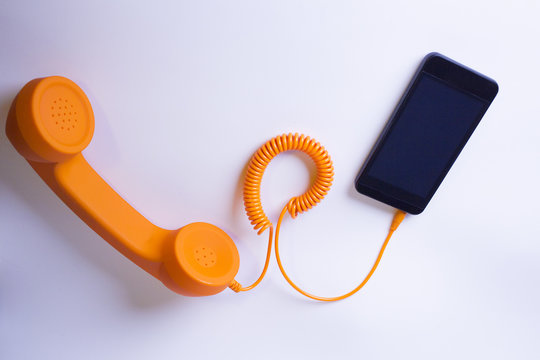 Orange analog phone and smartphone